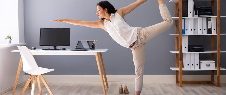 Woman doing yoga in the home office