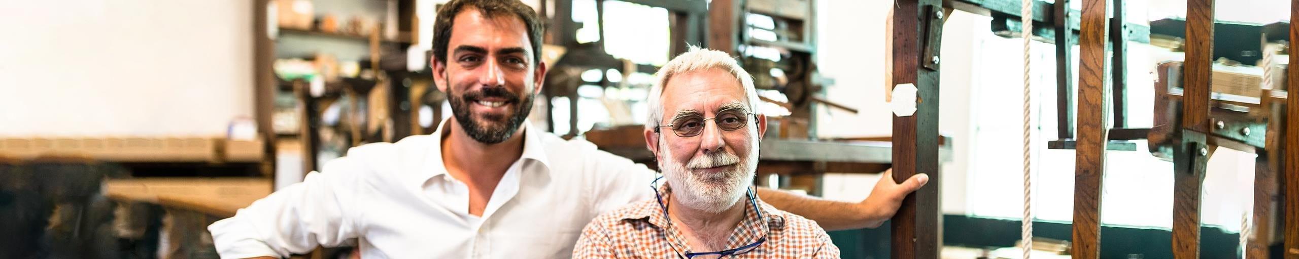 Portrait father & son in the company