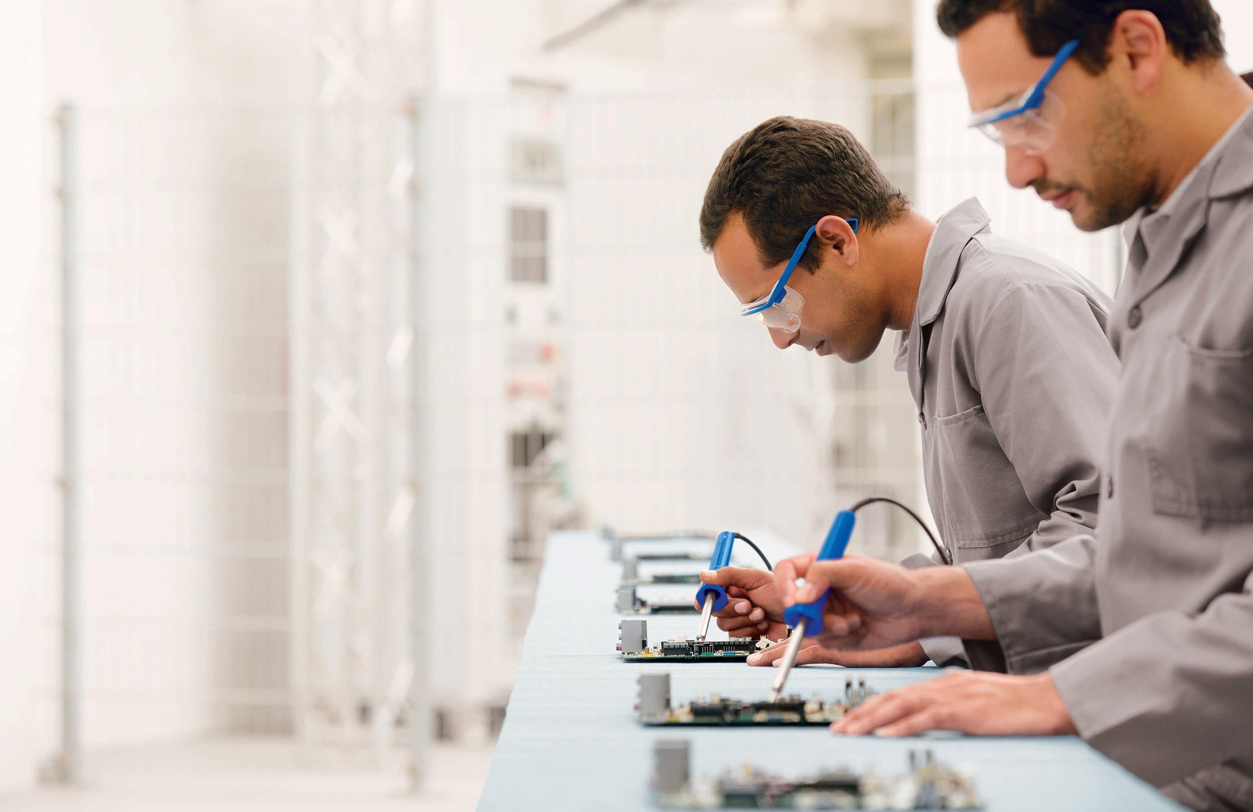 Men while soldering