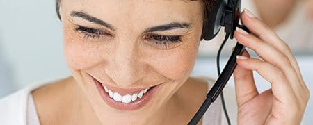 A woman wearing a headset.