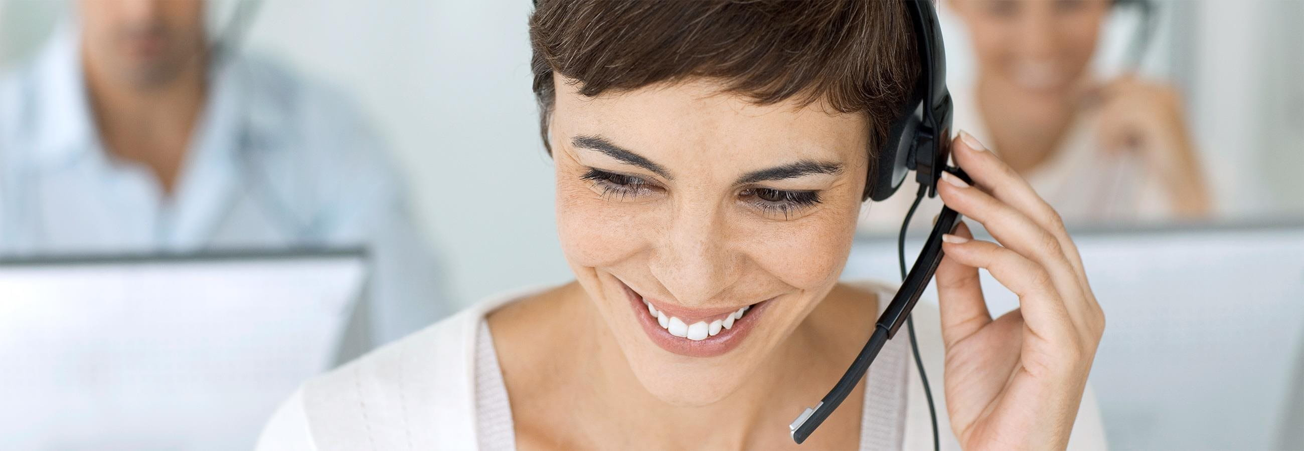 A woman wearing a headset.
