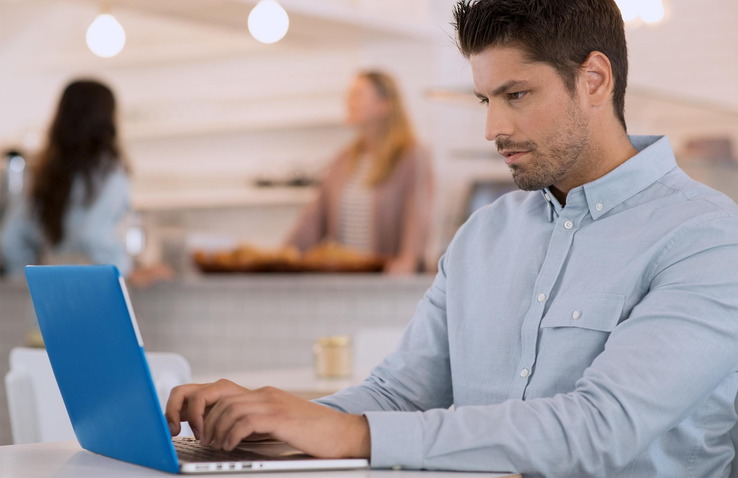 A man fills out an e-bill on his laptop.