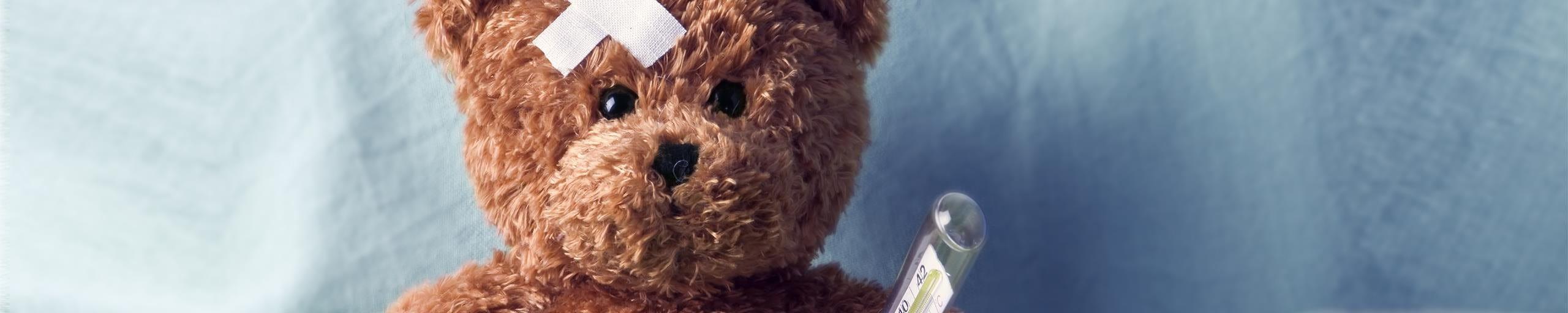 Teddy bear lying in bed.