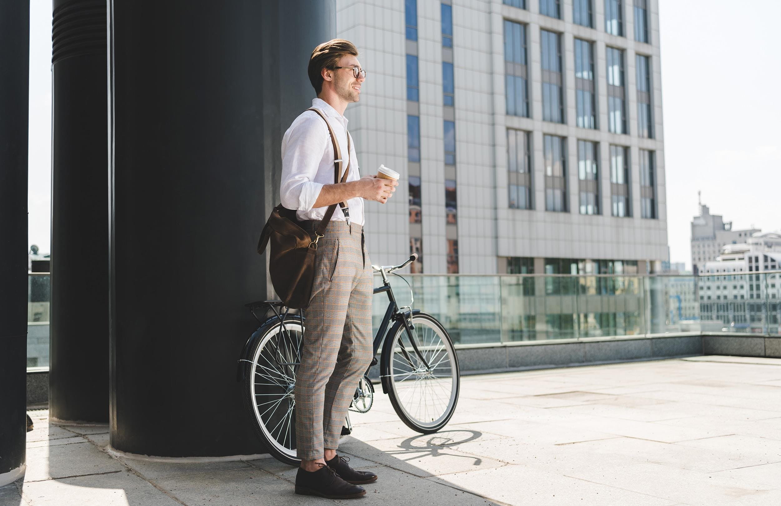 Young man with bike and coffee