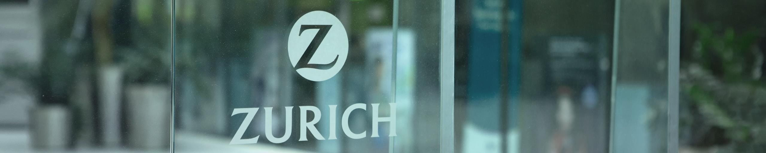The Zurich logo attached to a window.