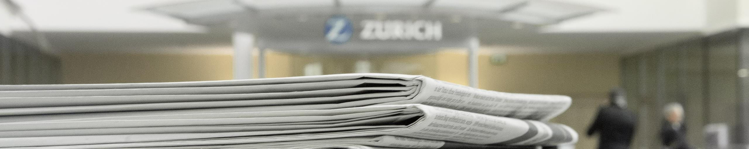 A stack of news papers in a Zurich building.