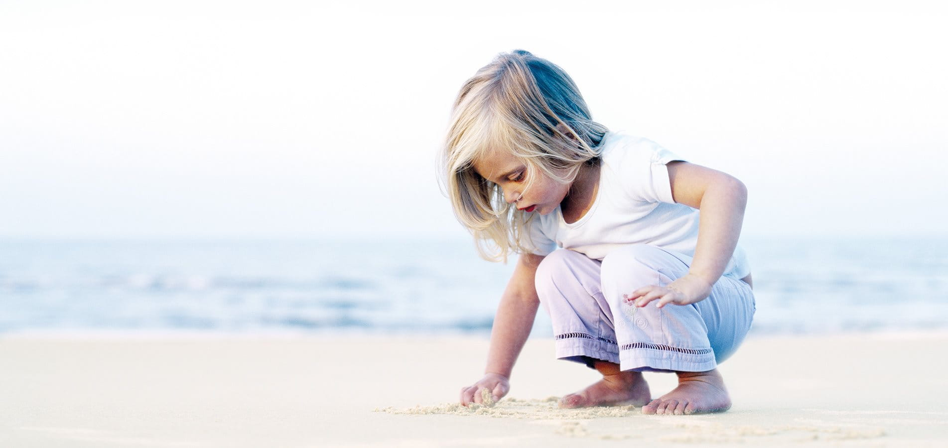 A little girl playing on the beach